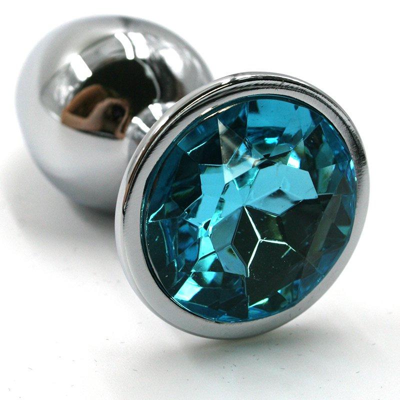 Средняя анальная пробка KANIKULE, серебряная с голубым стразом, 8х3,3 см